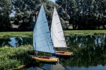 Blue sail is MAGIC built by Howard Goodrick in early 1970s and restored a few years ago. White sail is JARIC built in early 1980s.