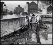 Repairing the wall at High Flags Wharf just after high tide and cancelled flood warnings October 8th 1964