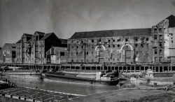 Barges moored alongside High Street warehouses no's, 18, 19 and 20