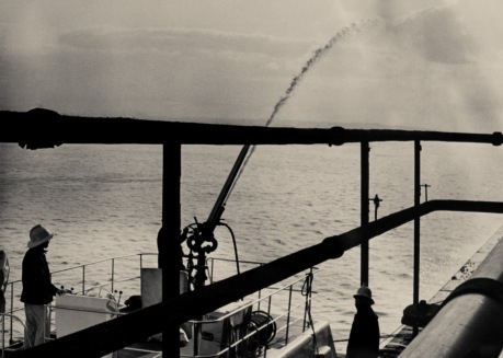 The fire boat added his jets from the river side of the blaze 1977